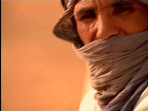 close up tilt up portrait middle-aged middle eastern man in turban outdoors / morocco - only mature men stock videos & royalty-free footage