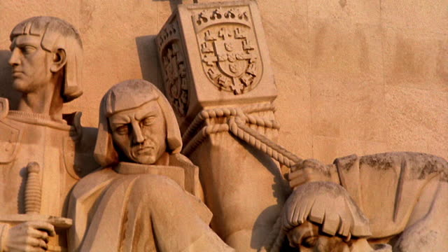 close up tilt up tilt down carved figures on monument to the discoveries / lisbon, portugal - monumento video stock e b–roll