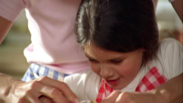 close up tilt up tilt down woman helping girl peeling potato / belgium - peel stock videos & royalty-free footage