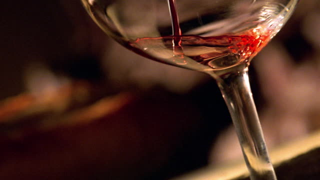 close up tilt up wine pouring in to wine glass - wine stock videos & royalty-free footage