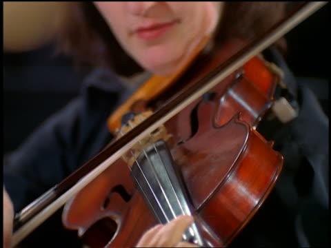 vídeos de stock, filmes e b-roll de close up tilt up woman playing viola in orchestra - só uma mulher de idade mediana