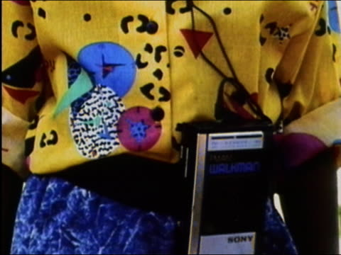 stockvideo's en b-roll-footage met 1989 close up tilt up young black girl using early walkman portable stereo attached to waist / audio - 1980 1989