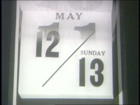 B/W 1962 close up time lapse desk calendar pages of May + June moving