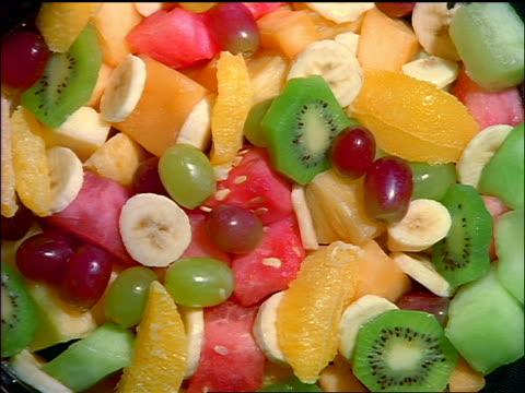 close up time lapse fruit salad rotting