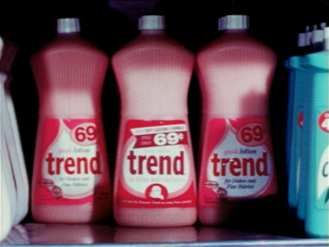 1965 close up time lapse grocery store shelf filling up with bottles of trend dishwashing liquid / educational - three objects stock videos & royalty-free footage
