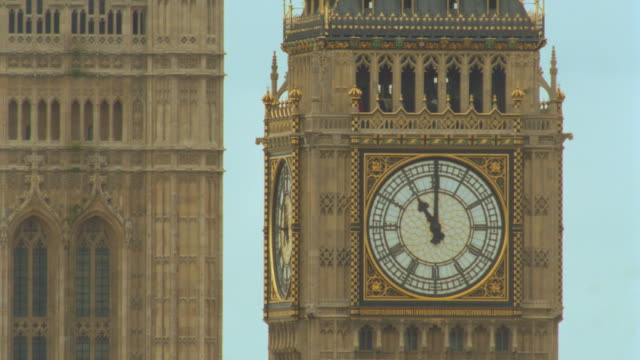 close up time lapse moving hands on clock face of big ben tower next to westminster abbey tower / london, england - big ben stock videos & royalty-free footage
