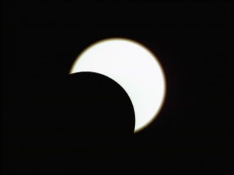 CGI close up time lapse reverse total solar eclipse