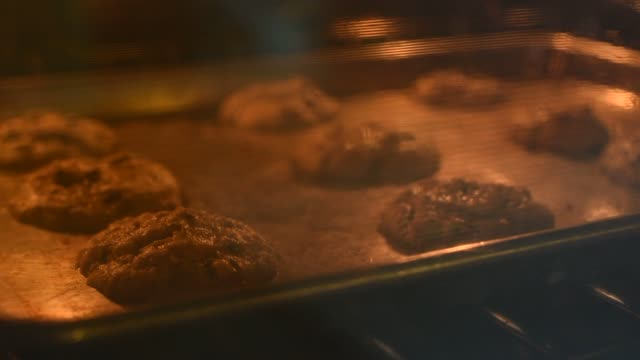 Close up time lapse shot of Pillsbury dough baking into cookies inside an oven in a kitchen in Illinois