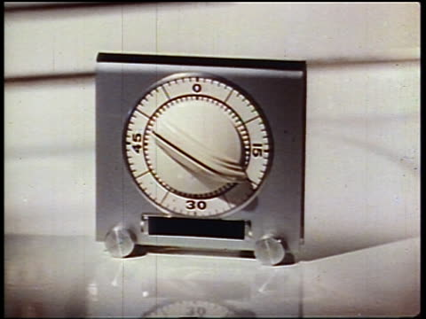 1950 close up timer on kitchen counter - conto alla rovescia video stock e b–roll