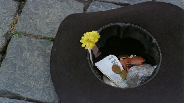close up tip hat filled with monetary donations on sidewalk / prague - donation box stock videos & royalty-free footage