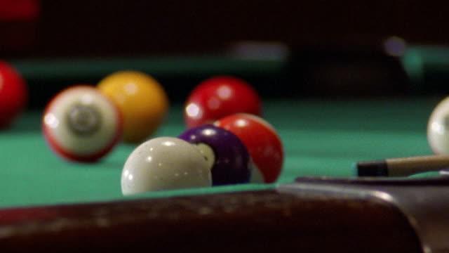 close up tip of cue stick being cued/ striking cue ball/ pan tilt up elderly female pool player/ san francisco - 1990 stock videos & royalty-free footage