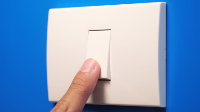 close up to turning off light bulb switch - light switch stock videos & royalty-free footage