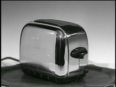 b/w 1951 close up toast popping up out of toaster / industrial - toaster appliance stock videos & royalty-free footage