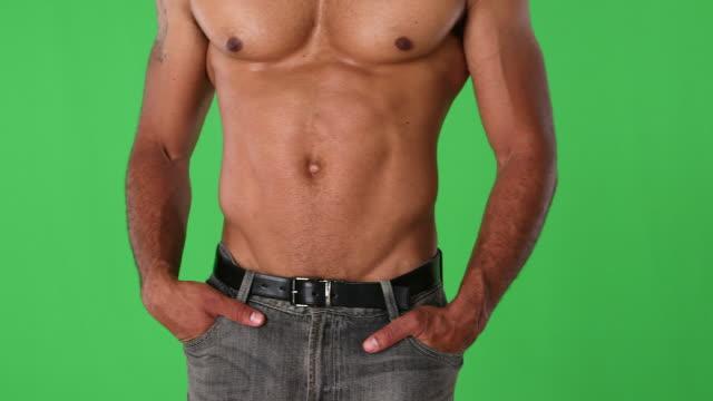 Close up torso of shirtless muscular man posing