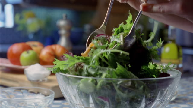 close up tossing salad in glass bowl - salad bowl stock videos & royalty-free footage