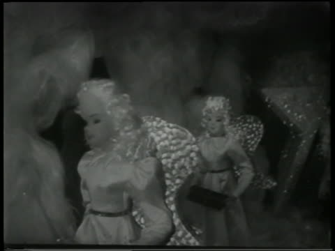b/w 1951 close up toy angels moving in window display - doll stock videos & royalty-free footage