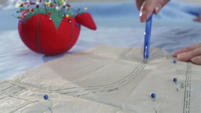 Close Up Tracing Wheel Being Run Over Sewing Pattern Stock Footage