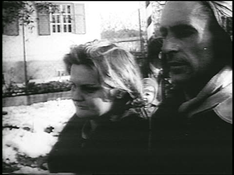 vídeos y material grabado en eventos de stock de close up tracking shot couple walks to austrian border / exiting hungary after revolution / newsreel - pareja de mediana edad