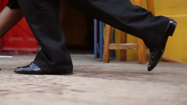 Close Up Tracking Shot Dancers perform a Tango at La Boca on September 11 2013 in Buenos Aires Argentina