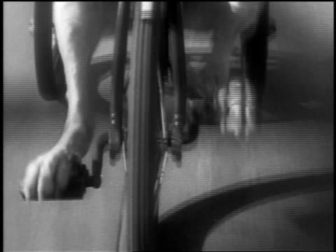b/w 1936 close up tracking shot feet of dog pedaling on tricycle - tricycle stock videos & royalty-free footage
