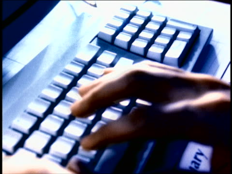 blue overexposed close up tracking shot hands of man typing on computer keyboard - overexposed stock videos & royalty-free footage