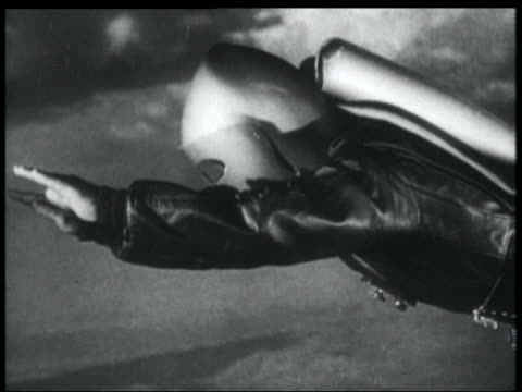 vídeos de stock, filmes e b-roll de b/w 1952 close up tracking shot man in jet pack + helmet flying - ator