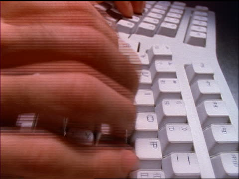 stockvideo's en b-roll-footage met close up tracking shot man's hands typing on curved (ergonomic) computer keyboard - 1997