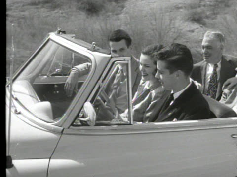 b/w 1949 close up tracking shot of 6 people riding in convertible - 1949 stock videos & royalty-free footage