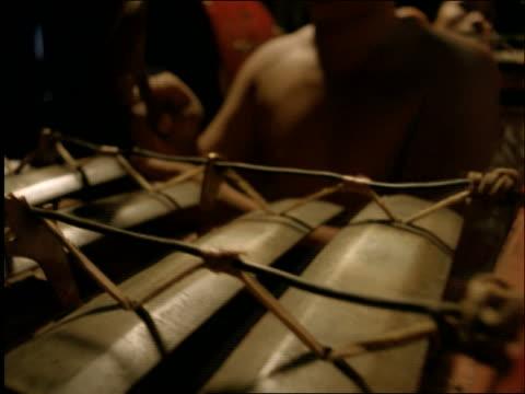 close up tracking shot of men playing xylophone-like balinese gamelan gongs / ubud / bali / indonesia - ubud district stock videos & royalty-free footage