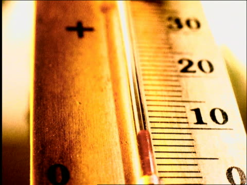 close up tracking shot of mercury rising on thermometer (centigrade) - thermometer stock videos & royalty-free footage
