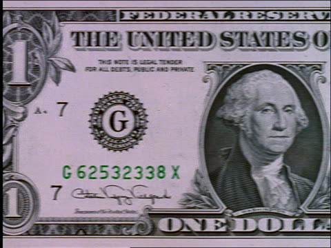 close up tracking shot of US dollar bill