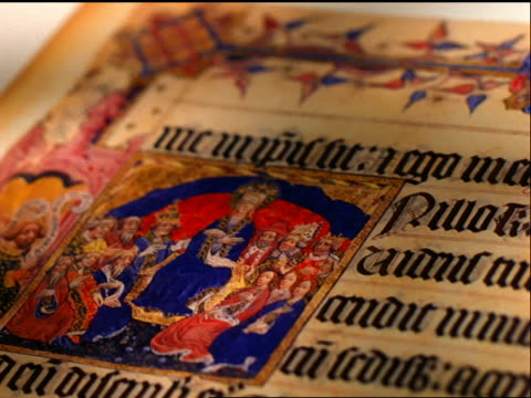 close up tracking shot over illuminated medieval manuscript