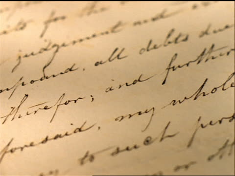 close up tracking shot over letter written with quill on yellowing paper - 手書き文字点の映像素材/bロール