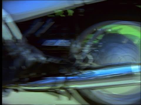 close up tracking shot shaky cam of man riding motorcycle