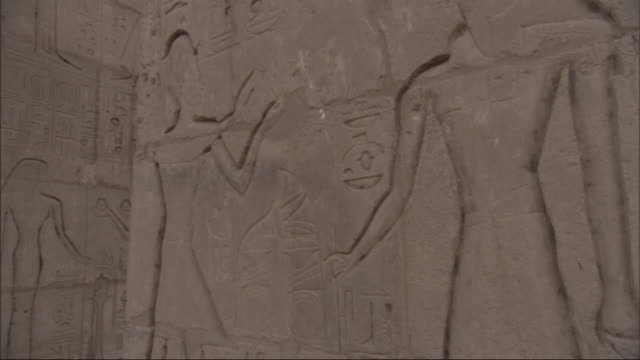 Close Up,  tracking-right - Ancient Egyptian carvings cover stone slabs at an archeological site