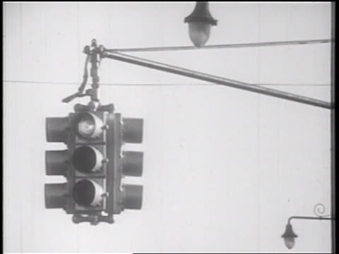 B/W 1939 close up traffic light changing / documentary
