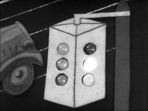 B/W 1938 close up traffic light with small lightbulbs on diagram of street corner