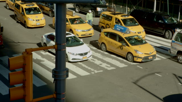 close up traffic time square intersection new york city - yellow taxi video stock e b–roll