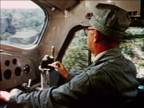 1954 close up train engineer driving train / houses go by outside window / industrial - 1954 stock videos and b-roll footage
