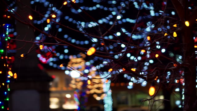 close up, tree covered in holiday lights in new mexico - christmas lights stock videos & royalty-free footage