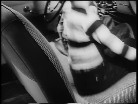 b/w 1950 close up two boys bouncing up + down on car seat - ford motor company stock videos and b-roll footage