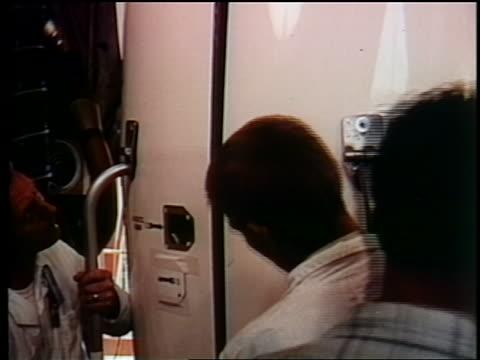 1962 close up two men preparing telstar for launch / documentary - telstar stock-videos und b-roll-filmmaterial
