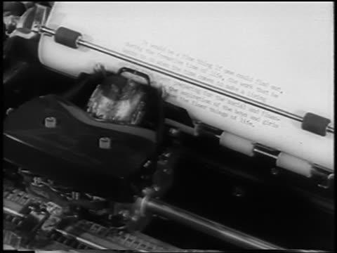 b/w 1961 close up typewriter typing words on paper / newsreel - typewriter stock videos & royalty-free footage