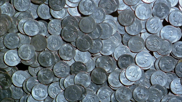 close up us coins disappearing - coin stock videos & royalty-free footage