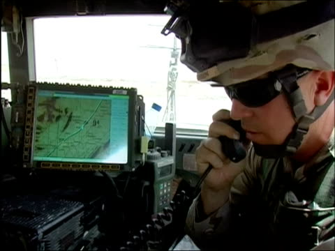 close up us soldier talking on the phone in vehicle / ghazni afghanistan / audio - only mid adult men stock videos & royalty-free footage