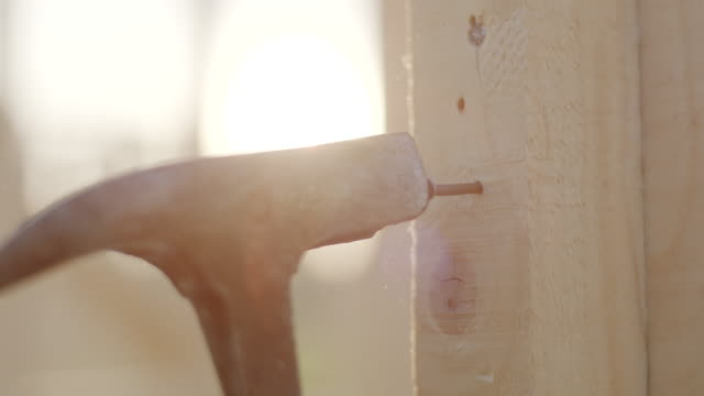 close up, using hammer to stuck nail in to the wood - wood material stock videos & royalty-free footage