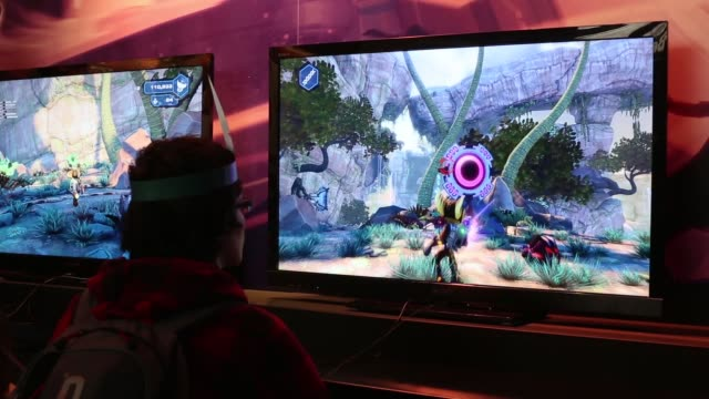 close up, video game enthusiasts play the latest release games at the eurogamer expo at earls court exhibition centre on september 26, 2103 in... - earls court stock videos & royalty-free footage