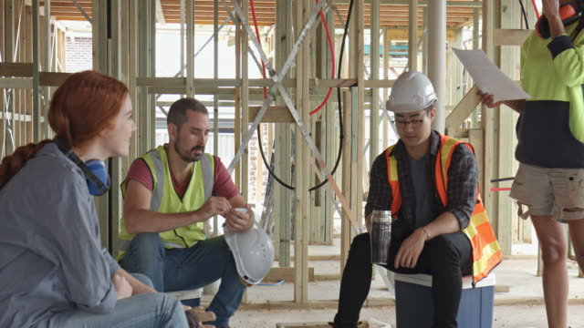 close up video of diverse construction workers on the coffee break - construction site stock videos & royalty-free footage