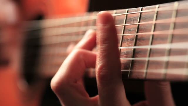 close up video of guitarists hands macro - musical instrument string stock videos and b-roll footage