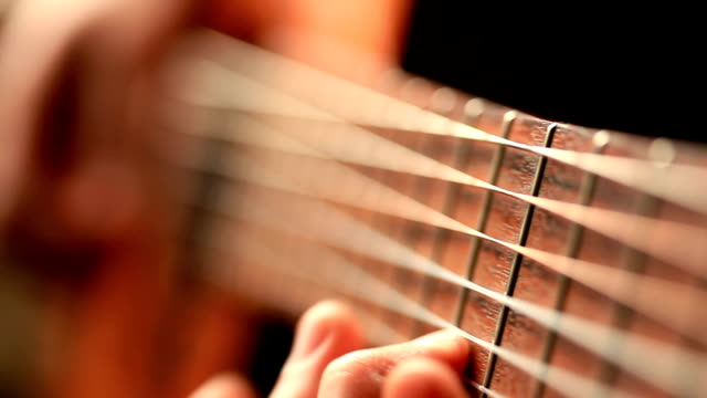 Close up video of guitarists hands macro